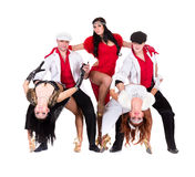Cabaret dancer team dressed in vintage costumes. Cabaret dancer team dancing.  Isolated on white background in full length Royalty Free Stock Image