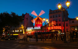 The cabaret famous Moulin Rouge at night,Montmartre area, Paris , France. Stock Photos