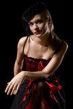 Cabaret girl. Attractive cabaret with net over her face leaning forward on her one knee Stock Photos