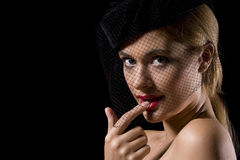 Cabaret girl. Attractive cabaret with net over her face and finger in mouth Royalty Free Stock Image