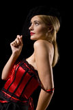 Cabaret girl. Attractive cabaret with net over her face while holding onto the net Royalty Free Stock Image