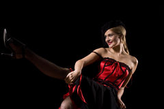 Cabaret girl kick. Attractive cabaret with net over her face kicking and showing her stockings Royalty Free Stock Photos