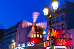 The cabaret Moulin Rouge in evening , Paris, France. Stock Photo
