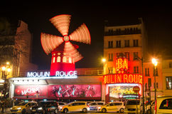 Cabaret Moulin Rouge in Paris. PARIS - MARCH 21: The Moulin Rouge by night, on March 21, 2015 in Paris, France. Moulin Rouge is a famous cabaret built in 1889 royalty free stock image