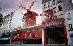 Cabaret Moulin Rouge in a sunset day at Montmartre, Paris, France. Moulin Rouge is a famous cabaret built in 1889 Royalty Free Stock Photos