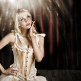 Cabaret showgirl on smoky theater stage Stock Photo