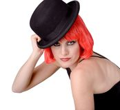 Cabaret Woman With Red Wig. Woman with red wig tipping a black felt top hat Royalty Free Stock Photos