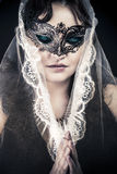Woman in veil and black dress, glamour scene Royalty Free Stock Photo