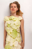 Cabbage. A young woman covered with collard greens stock image