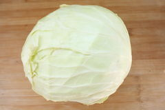 Cabbage. Fresh cabbage  on wood Royalty Free Stock Images