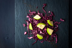 Cabbage and apples salad on the dark stone top view Stock Photos