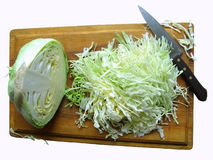 Cabbage on the breadboard. Half head of cabbage,knife and choped cabbage on the breadboard Stock Photo