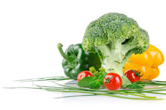Cabbage broccoli with tomatos and green leaves Royalty Free Stock Photography