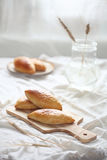 Cabbage buns on wooden cutting board Royalty Free Stock Photo