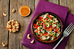 Cabbage carrot red bell pepper cashews salad. Toning. selective focus stock images