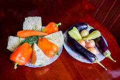 Cabbage, carrots and bell peppers with dill. Eggplant and onions.  Stock Photo