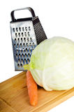 Cabbage and carrots on a kitchen board Royalty Free Stock Photography