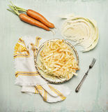 Cabbage carrots salad in plate with fork and ingredients, top view Royalty Free Stock Photo