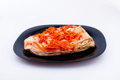 Cabbage with carrots. On the white plate Stock Images