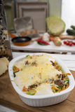 Cabbage casserole with mincemeat, bechamel sauce and cheese Stock Images