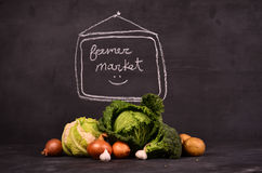 Cabbage, cauliflower , broccoli potatoes, onions, garlic and hand drawn sign  ferme market Royalty Free Stock Photography