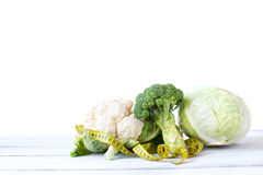 Cabbage and cauliflower with a measure. Concept diet. Royalty Free Stock Image