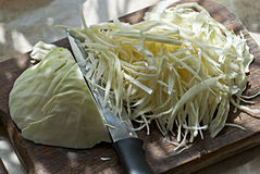 Cabbage on chopping board. Cabbage sliced on chopping board Royalty Free Stock Image