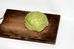 Cabbage on the chopping borad on white background stock photos