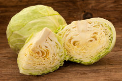 Cabbage and cut cabage on wooden board Stock Images