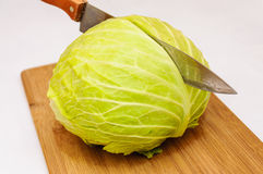 Cabbage cut knife wooden table Royalty Free Stock Image