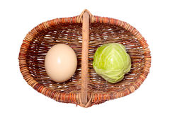 Cabbage and eggs  in a basket. Cabbage and some eggs  in a Wicker basket Stock Image