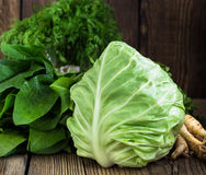 Cabbage. Fresh raw green vegetables on wooden background Stock Photography