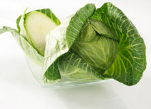 Cabbage and a half. On a glass plate royalty free stock photo