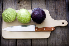 Cabbage and knife on cutting board Royalty Free Stock Image