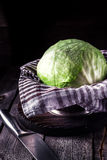 Cabbage and knife on dark wooden background. Royalty Free Stock Photos