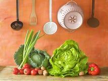 Cabbage, lettuce, kitchen utensils Stock Photo