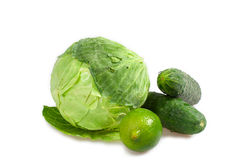 Cabbage, lime, two cucumbers Stock Photography
