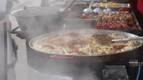 Cabbage with meat in hot steam stock video footage