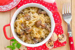 Cabbage with mushrooms Stock Photos