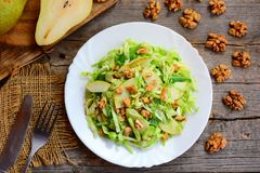 Cabbage and pear slaw recipe. Healthy salad with raw pear, Stock Image