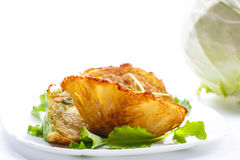 Cabbage pieces fried in batter with salad Royalty Free Stock Image