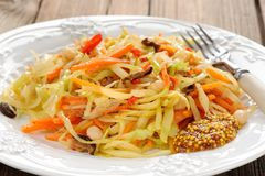 Cabbage ragout with carrot, chili, mushrooms and french mustard Royalty Free Stock Image