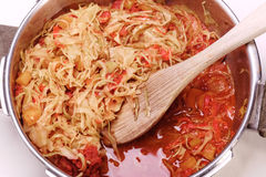 Cabbage and red peppers in pressure cooker Stock Photo