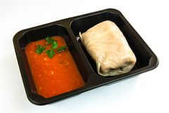 Cabbage roll stuffed with meat, rice and vegetables. With tomato sauce in a take-out package Royalty Free Stock Images
