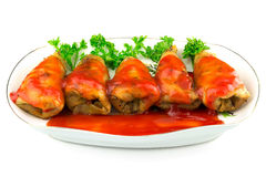 Cabbage roll with tomato sauce and parsley in plate, isolated on white background Stock Photo