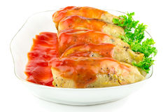 Cabbage roll with tomato sauce and parsley in plate, isolated on white background Royalty Free Stock Photography