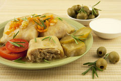 Cabbage rolls with olives and sour cream Royalty Free Stock Photos