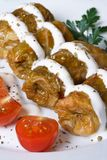 Cabbage rolls with sour cream macro. Vertical Royalty Free Stock Photography