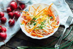 Cabbage salad.  cabbage salad with sweet carrot, radish, bow in Stock Photo