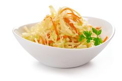 Cabbage salad with carrots, in white bowl Royalty Free Stock Images